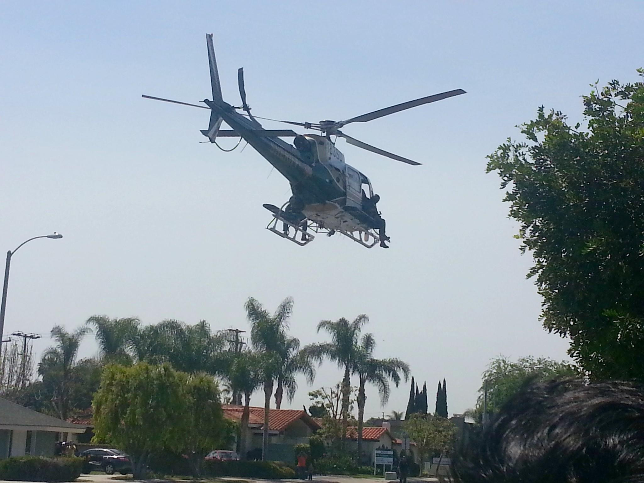 A helicopter is used amid a SWAT response to the armed gunman search in Tustin on Thursday.