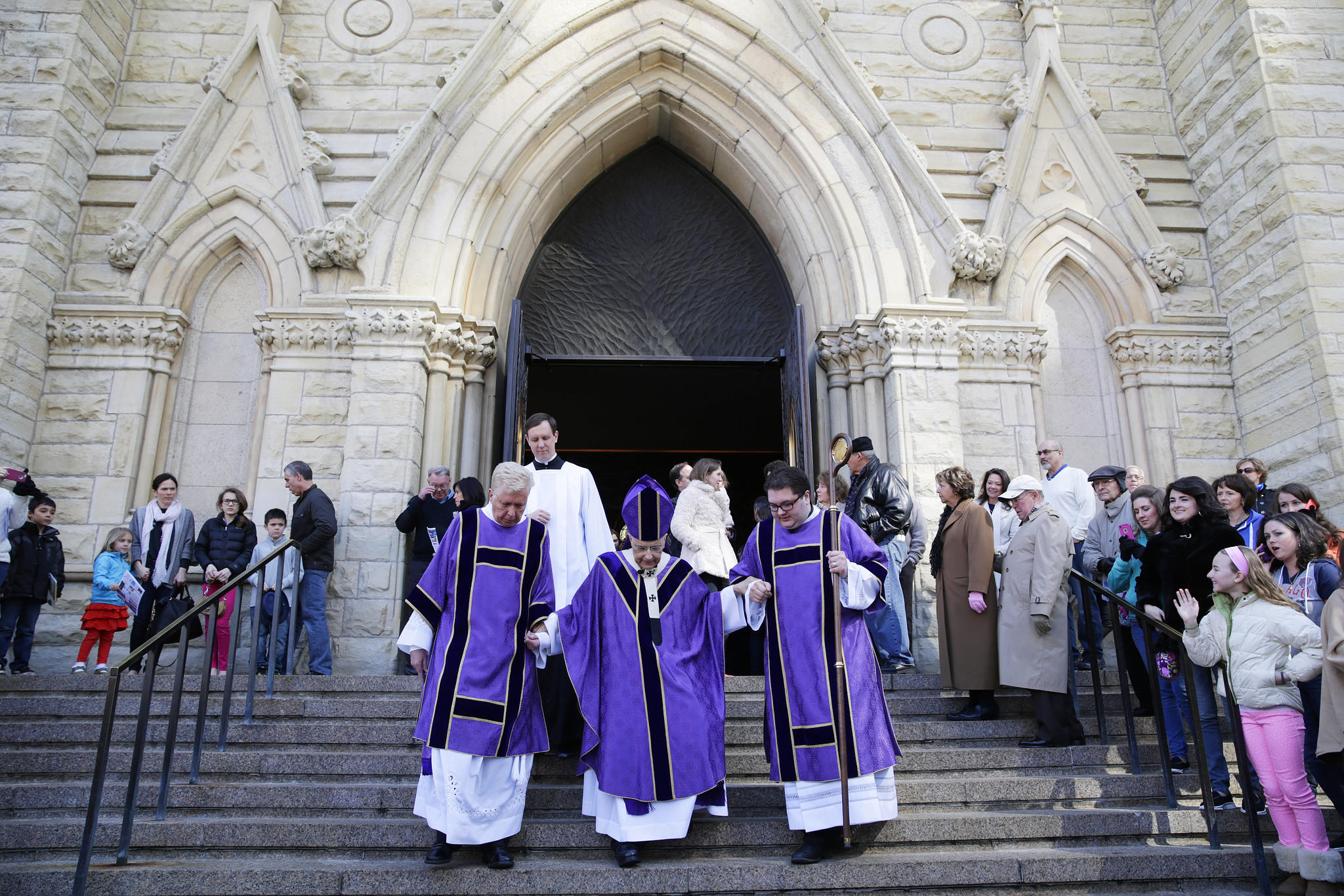 Cardinal Francis George, center, is helped down the steps of Holy Name Cathedral by Deacon Stan Strom, left, and Deacon Brad Zamora, following Mass on Sunday at Holy Name Cathedral.
