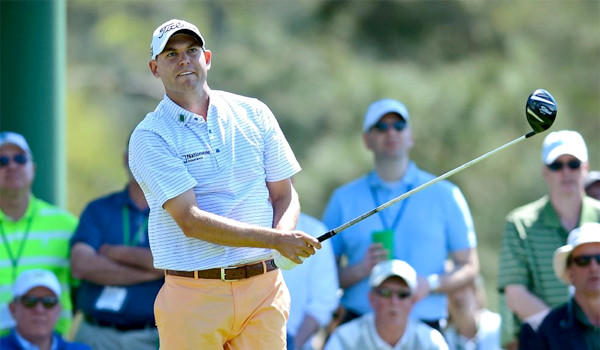Bill Haas watches the flight of his drive from the 18th tee during the first round of the Masters on Thursday at Augusta National.