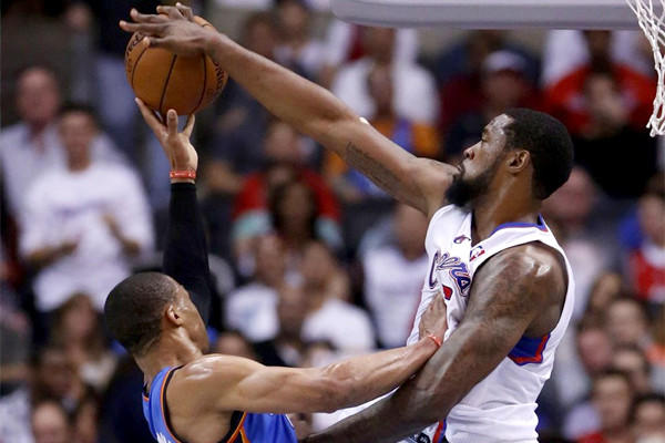 DeAndre Jordan blocks Oklahoma City guard Russell Wilson's shot during the first half of the Clippers' 107-101 loss Wednesday to the Thunder.