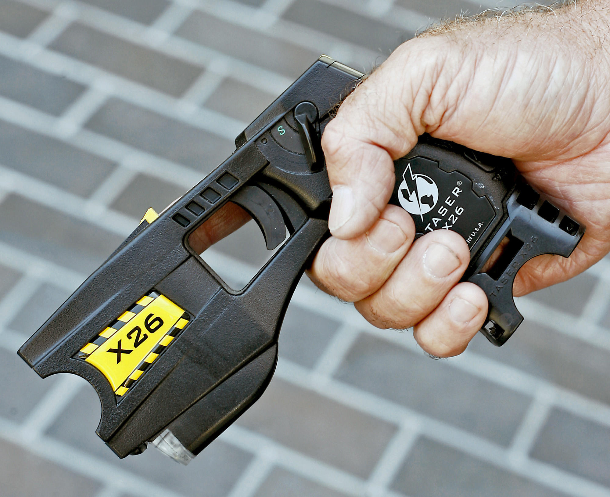 Police Officer Patrick Richardson holds one of the Glendale Police Department's Taser guns in Glendale on Monday, June 18, 2007. The department will will soon receive new Tasers with the added capability to record more information about incidents when deployed.