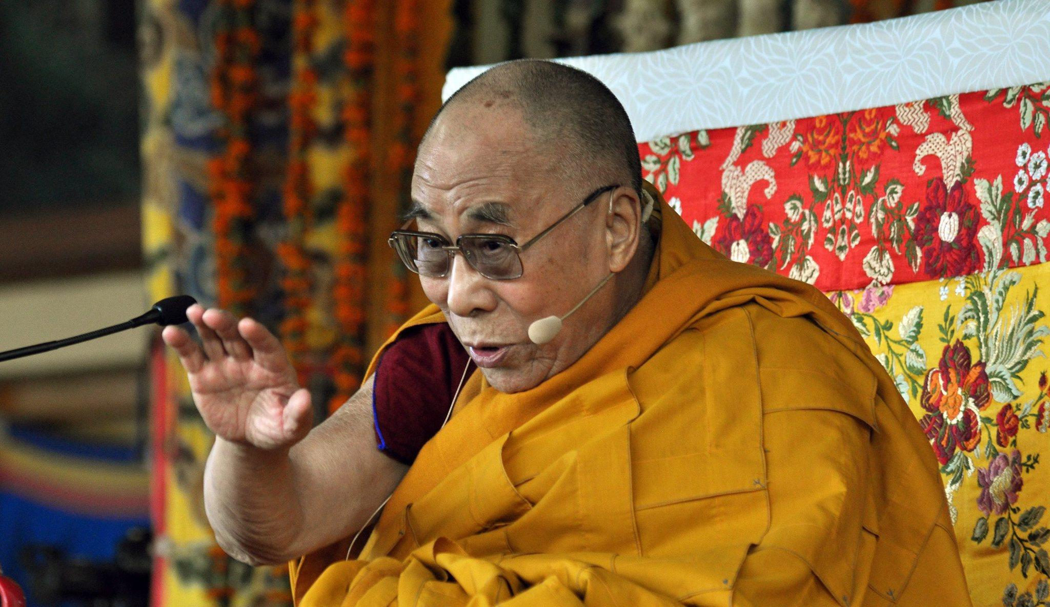 The Dalai Lama gestures as he speaks during a session of short teaching from the Jataka Tales at the main Tibetan Tsuglagkhang temple at McLeodGanj in India.