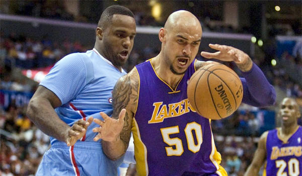 Robert Sacre, right, boxes out the Glen Davis, left, while grabbing a rebound during the first half of the Lakers' loss to the Clippers, 120-97, on April 6.