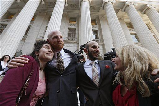 Plantiff Derek Kitchen, center left, and partner Moudi Sbeity hug relatives after the hearing.