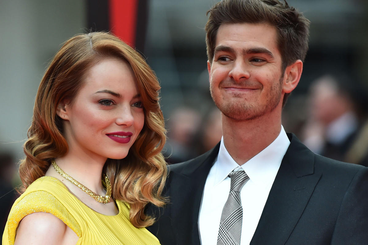 """Emma Stone amd Andrew Garfield arrive on the red carpet for the world premiere of """"The Amazing Spider-man 2"""" in London."""