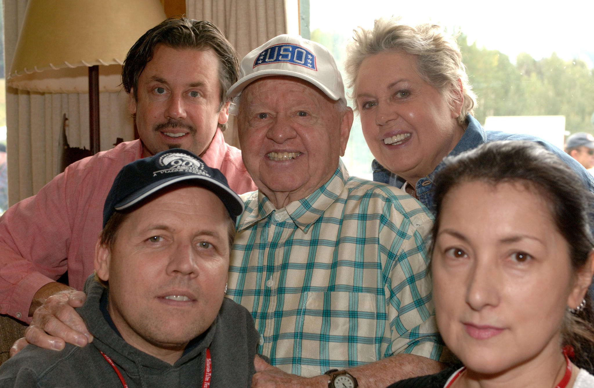 Mickey Rooney with his family, clockwise from upper left, son Chris, wife Jan, daughter-in-law Charlene, and son Mark.