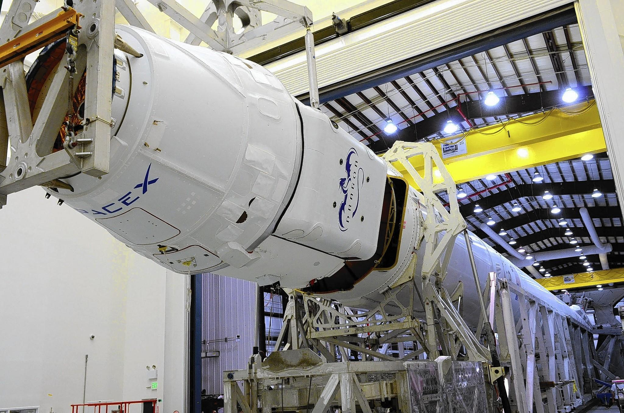 SpaceX asked lawmakers to clarify its tax status after the Los Angeles County Assessor audited the company in 2012 and issued an assessment dating to the 2007-08 fiscal year. Above, a SpaceX Dragon capsule is mated to the company's Falcon 9 rocket.