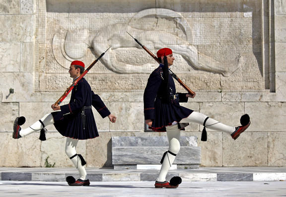 Greek presidential guards march at the monument of the unknown soldier in front of the parliament in Athens.