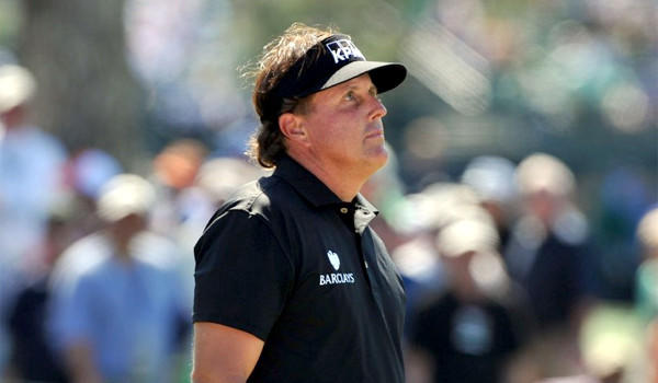 Phil Mickelson reacts to a triple bogey on the 7th hole of the Augusta National Golf Club on Thursday during the first round of the Masters. Mickelson shot a four-over-par 76.