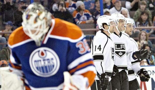Edmonton goalie Viktor Fasth, left, lowers his head after allowing a goal Thursday while Justin Williams (14), Marian Gaborik, center, and Alec Martinez, right, celebrate. Gaborik had two goals in the Kings' 3-0 win over the Oilers.