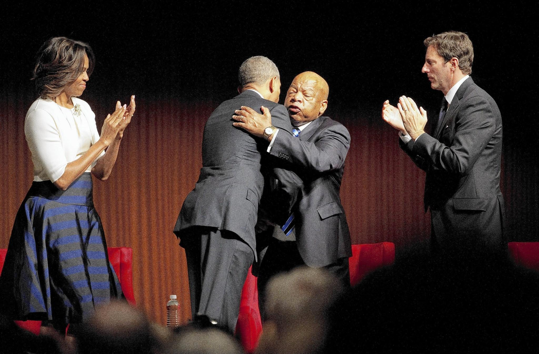 President Obama greets Rep. John Lewis (D-Ga.) after speaking on civil rights at the LBJ Presidential Library in Austin, Texas. Looking on are First Lady Michelle Obama and Mark Updegrove, the library's executive director.