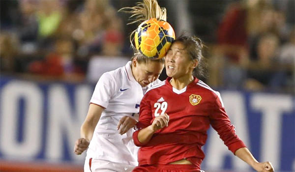 U.S. midfielder Morgan Brian and China forward Yang Li battle for a head ball during the United States' 3-0 win over China on Thursday at Qualcomm Stadium in San Diego.