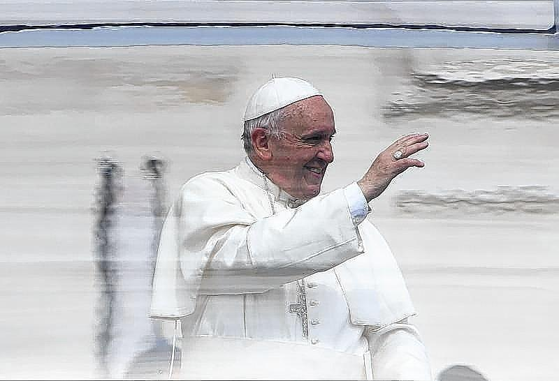 Pope Francis waves as he leaves the general audience in Saint Peter's square at the Vatican.