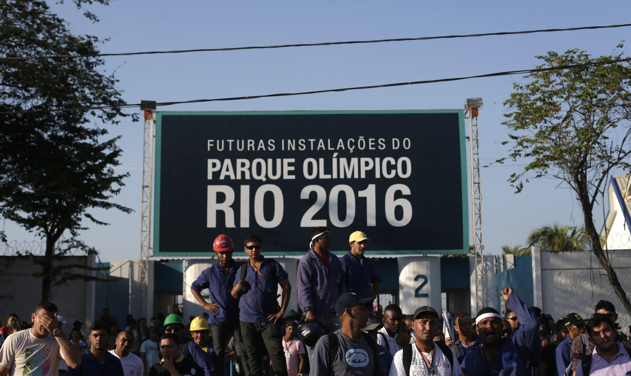 Construction workers on strike for more pay and better union representation stand outside the Rio 2016 Olympic Park construction site this week.