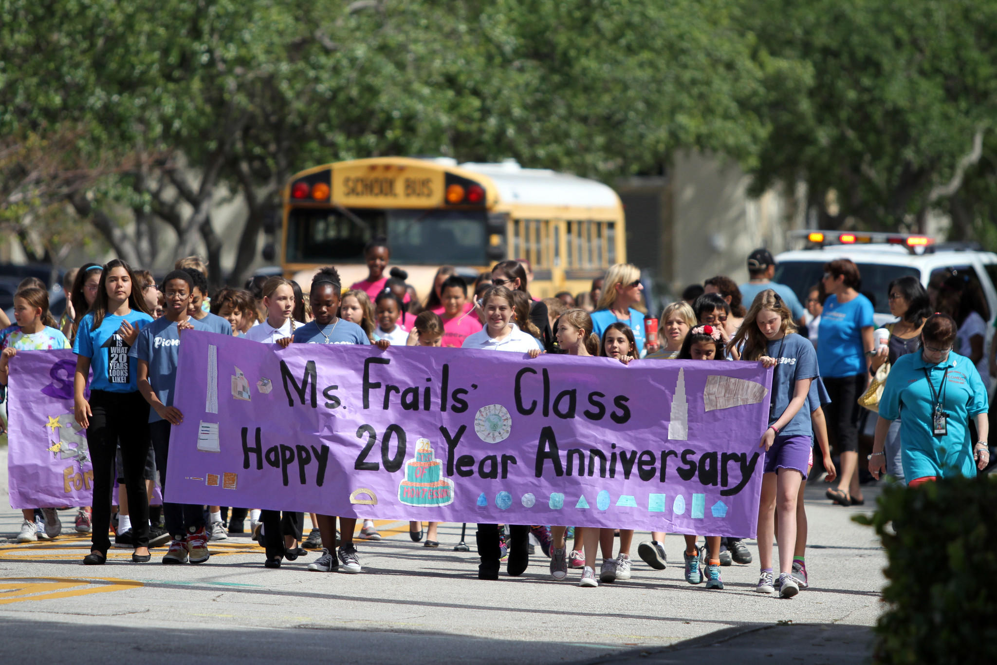 Students march in a parade for Virginia Shuman Young's 20th anniversary celebration on Friday, April 11, 2014.