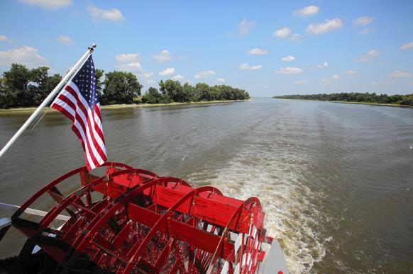 The paddle on The Spirit of Peoria paddlewheel boat as it heads down the Illinois River.
