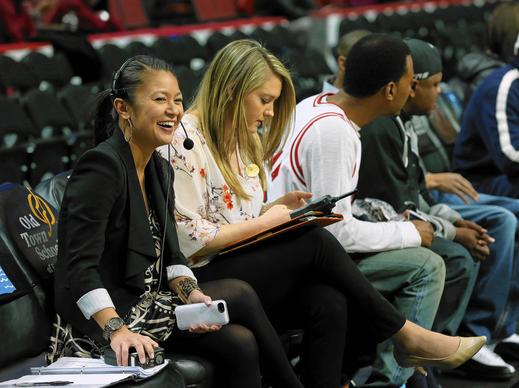 Director of Entertainment Michelle Harris laughs while preparing for a Chicago Bulls game at the United Center.