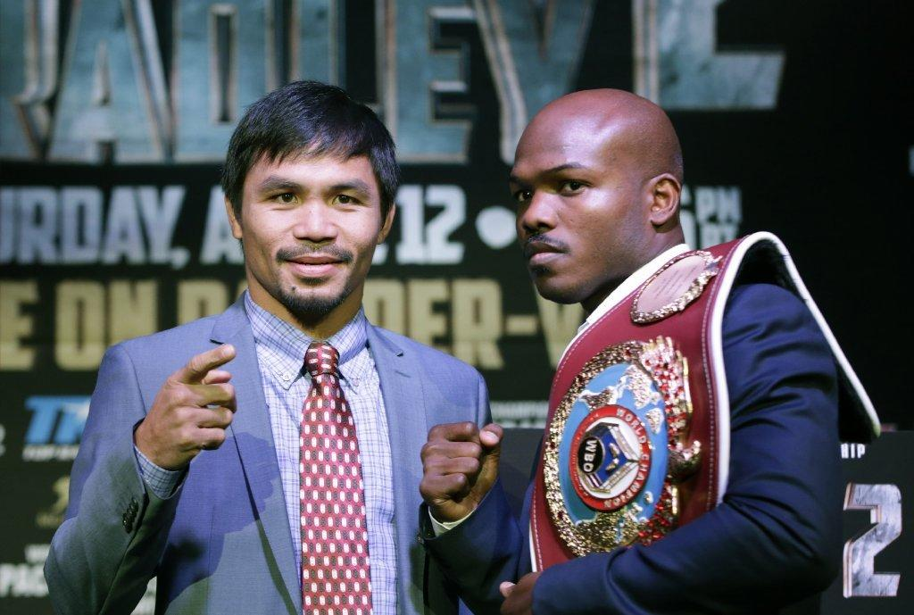 Manny Pacquiao, left, poses with Timothy Bradley on Feb. 6.