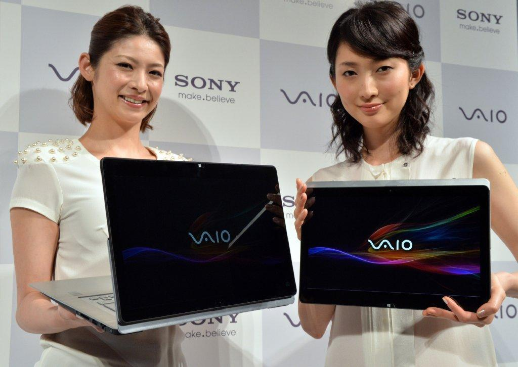 Sony is warning users of its Vaio Fit 11A that the laptop could contain a fire risk. Above, Sony reps with Vaio devices.