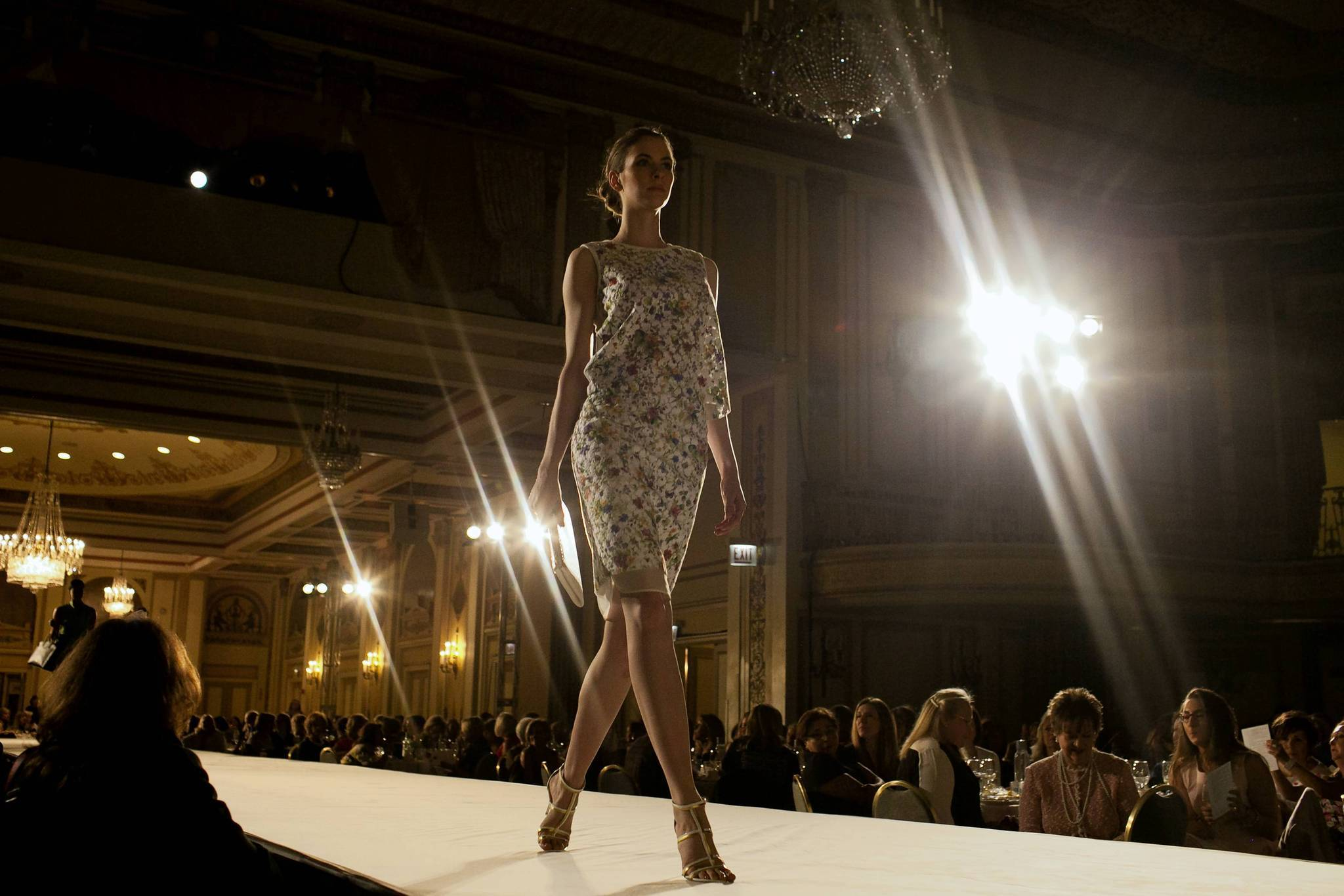 A model struts down the runway during the Misericordia Fashion Show and Luncheon.