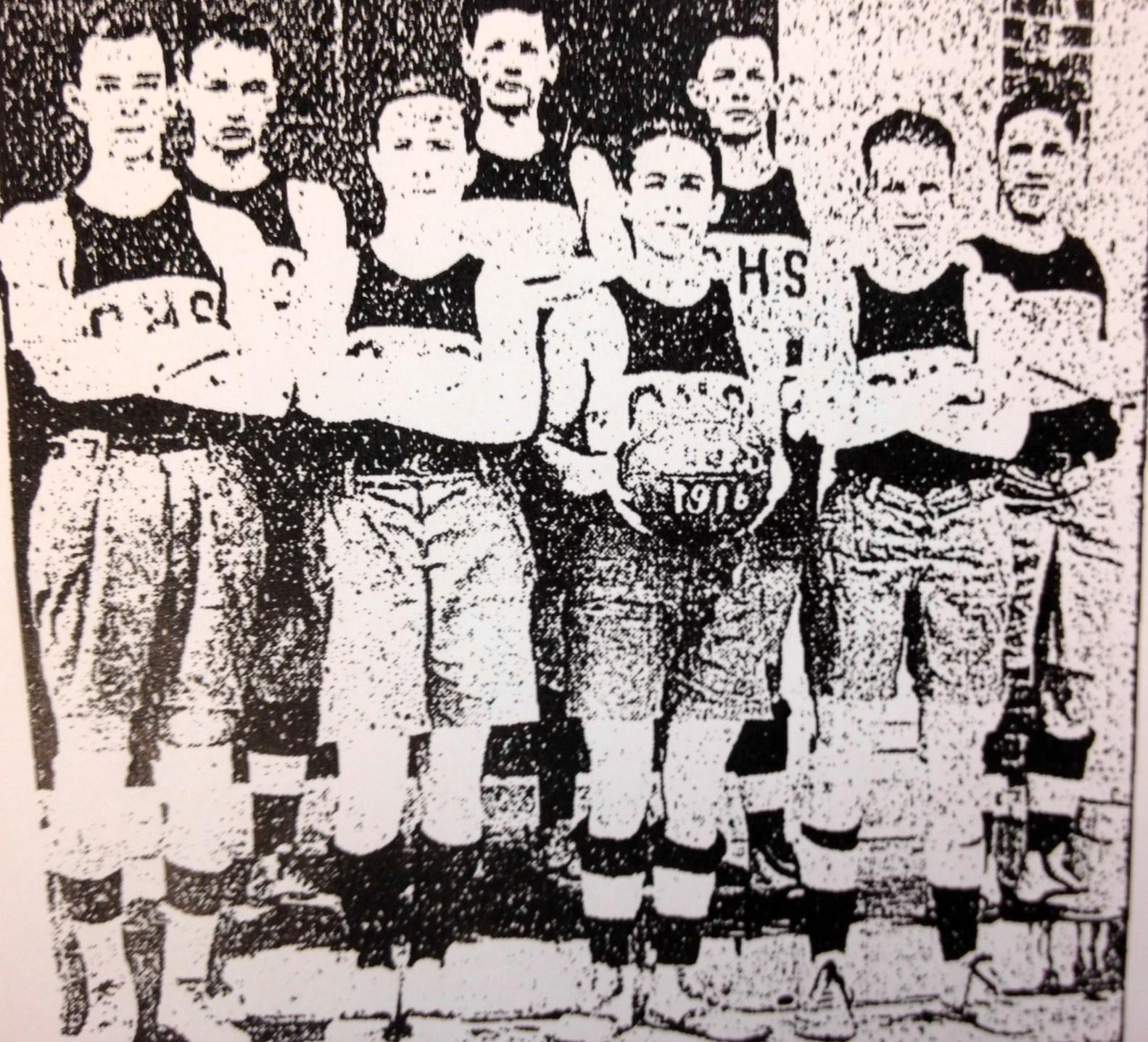Back Row: Moseley, manager and substitute; Turner, substitute; Holmes, right forward; Dickinson, substitute. Front Row: Williams, center; Reynolds, left forward; Carter, Captain, right guard; Dean, left forward