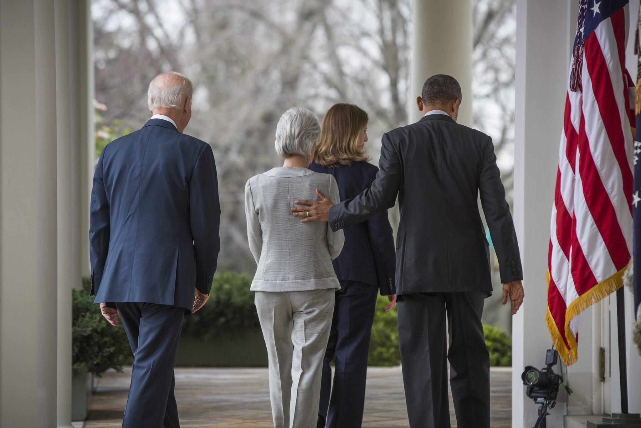 Outgoing Health and Human Services Secretary Kathleen Sebelius (in gray) and nominated successor, Sylvia Mathews Burwell, flanked by Vice President Biden and President Obama after Friday's announcement of the changeover.