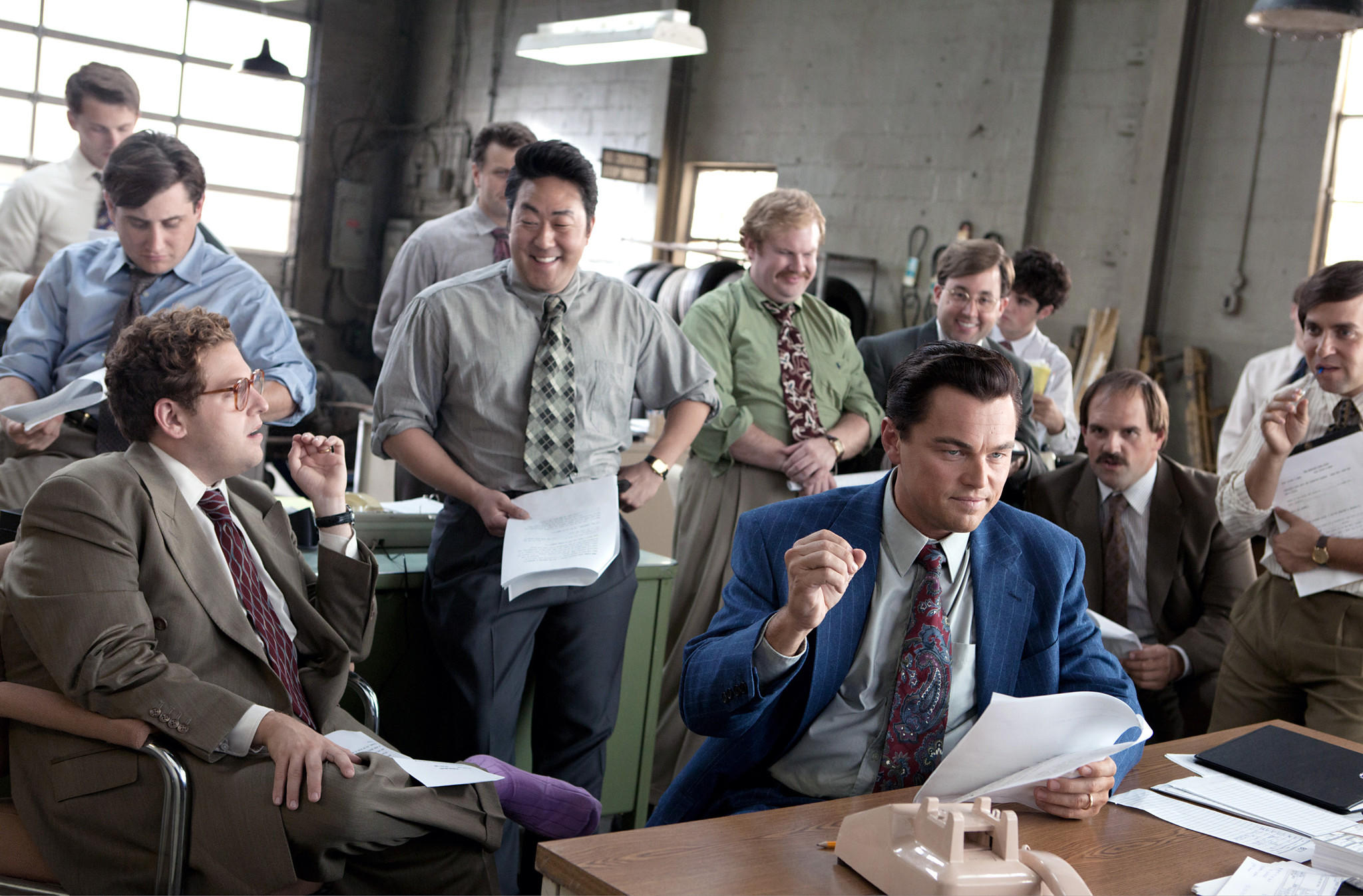"Foreground left to right: Jonah Hill is Donnie Azoff, Kenneth Choi is Chester Ming, Leonardo DiCaprio is Jordan Belfort, Henry Zebrowski is Alden Kupferberg (""Sea Otter""), P.J. Bryne is Nicky Koskoff (""Rugrat""), and Ethan Suplee is Toby Welch in The Wolf of Wall Street, from Paramount Pictures and Red Granite Pictures."
