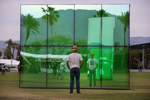 "A festival-goer gazes into the art installation ""Reflection Field,"" by Phillip K. Smith, at the Coachella Music and Arts Festival in Indio, Calif."
