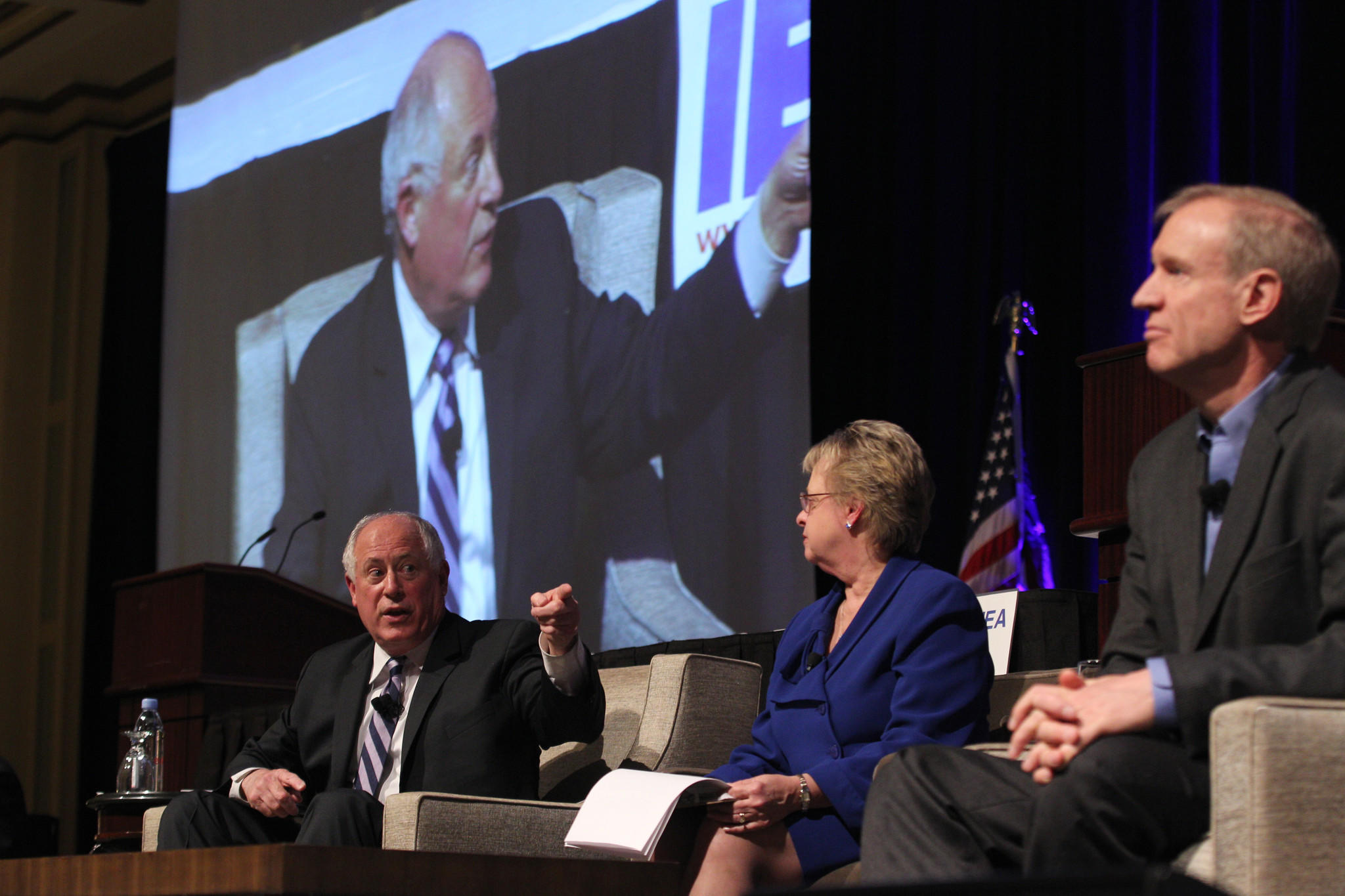Illinois Gov. Pat Quinn, left, and businessman Bruce Rauner, right, his opponent in the November election for governor, make their first joint appearance at the Illinois Education Association's annual meeting in Chicago.