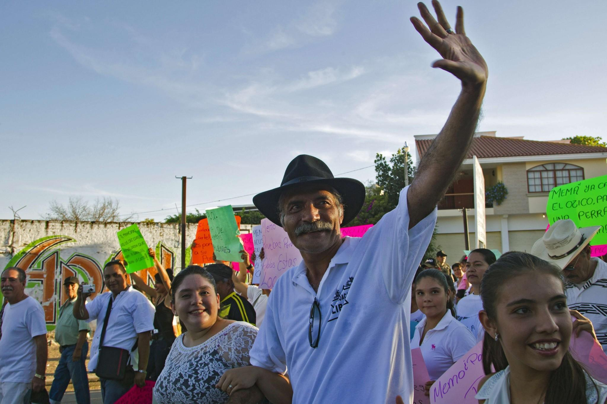 "Jose Manuel Mireles, a leader of a ""self-defense"" group in Mexico's Michoacan state, waves during a February march to celebrate the anniversary of the groups of civilians who say they took up arms to fight the drug cartels."