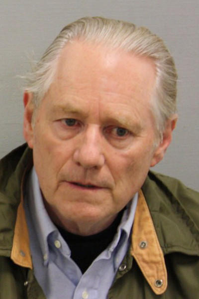 Roger G. Nielson, 65, was charged with 14 counts of first-degree larceny and 15 counts of second-degree larceny.