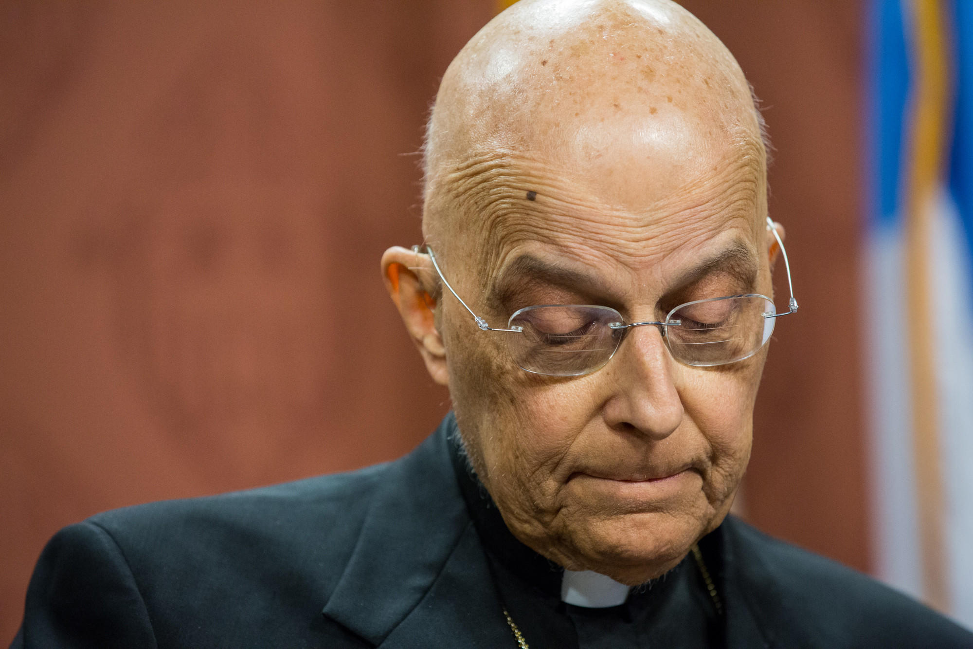 Cardinal Francis George talks about his health at a news conference today.