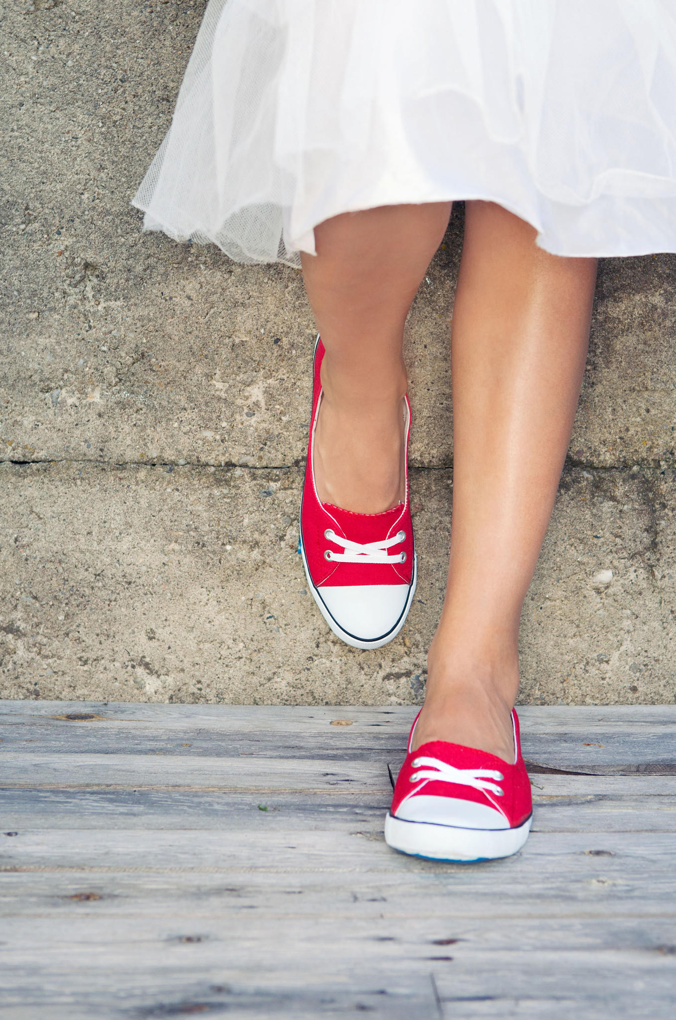 Slip-ons are your best bet if you're going to pair your sneakers with a dress or skirt.