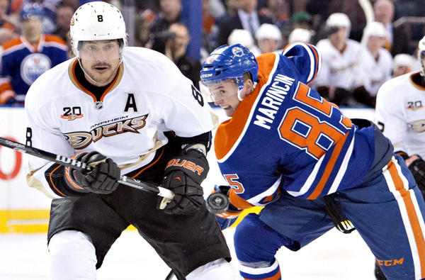 Ducks right wing Teemu Selanne tracks the puck during a battle against Edmonton's Martin Marincin in a game last month.