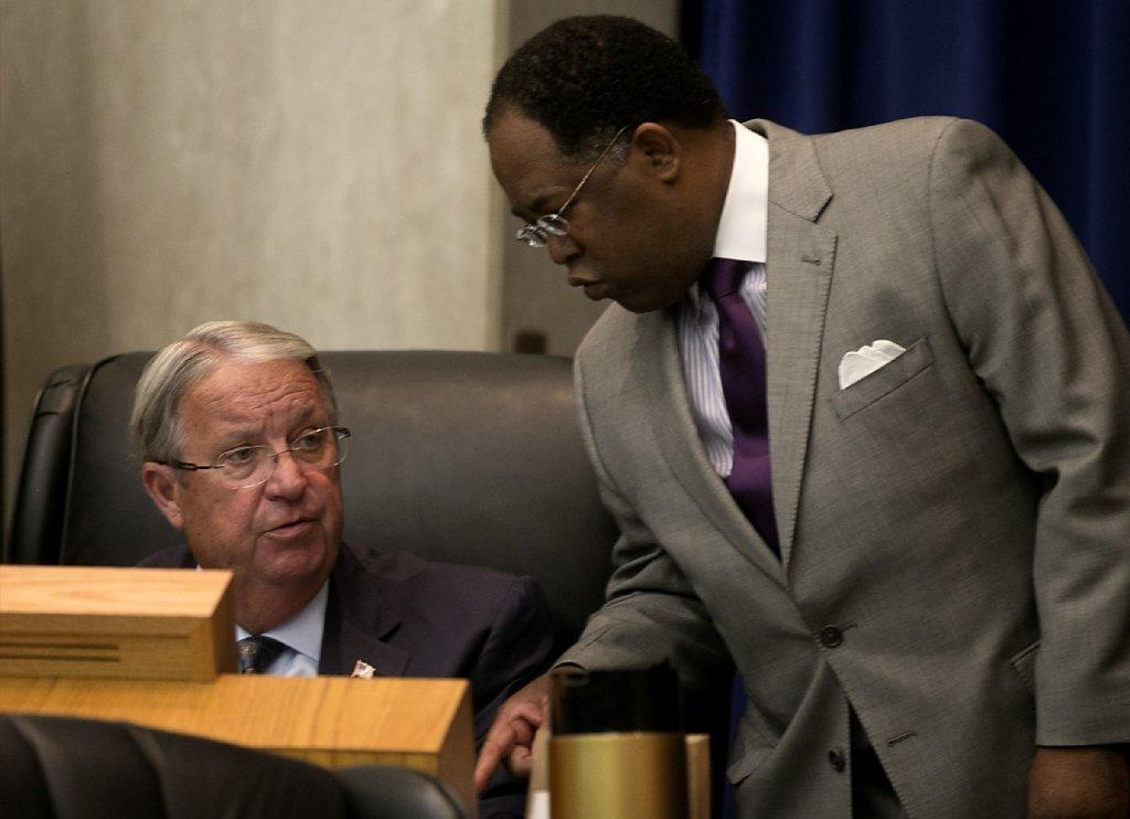Los Angeles County Supervisors Mark Ridley-Thomas, right, and Don Knabe are seen during a 2013 board meeting. The Board of Supervisors is weighing recommendations by a commission on ways to fix child protection services in the county.