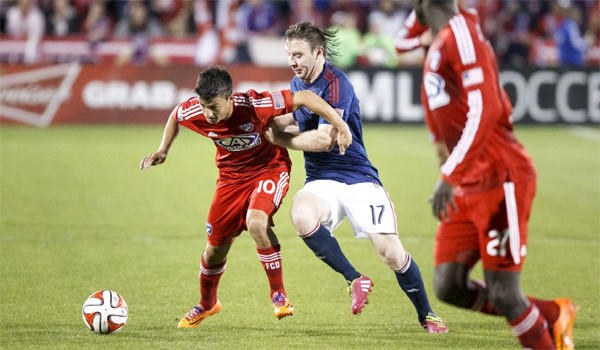 Chivas USA's Thomas McNamara, right, and FC Dallas' Mauro Diaz, left, battle for control of the ball during a match on March 22.