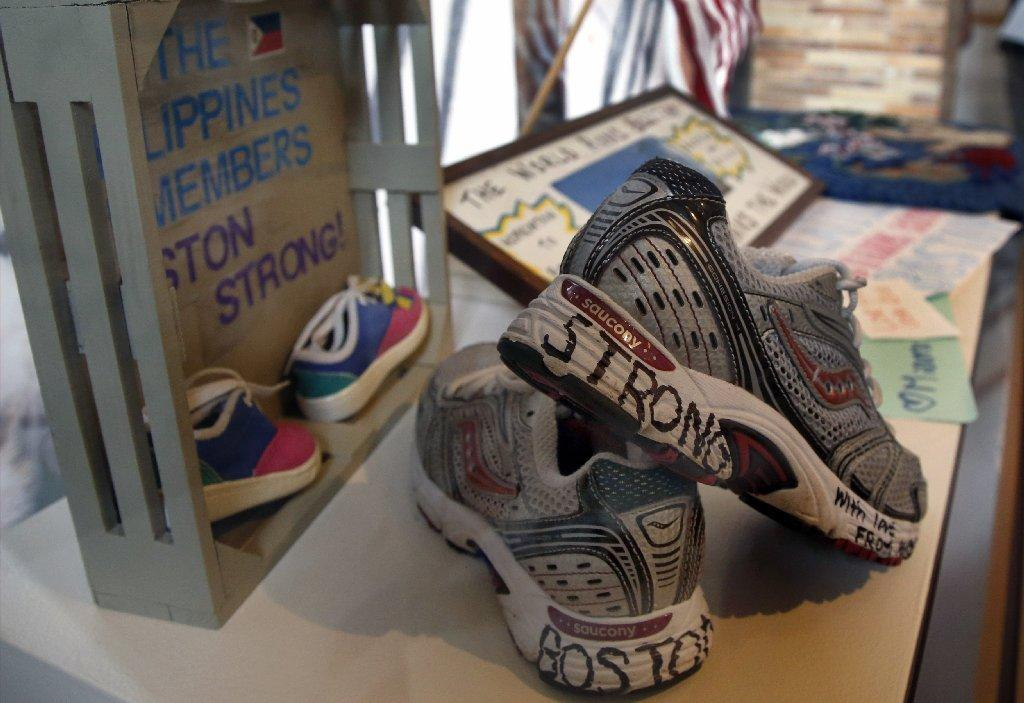 "Part of an exhibit entitled ""Dear Boston: Messages from the Marathon Memorial"" is seen on display last week at the Boston Public Library. Messages of resilience, solidarity, hope and love are embodied at the memorial exhibit commemorating the anniversary of the 2013 Boston Marathon bombings."