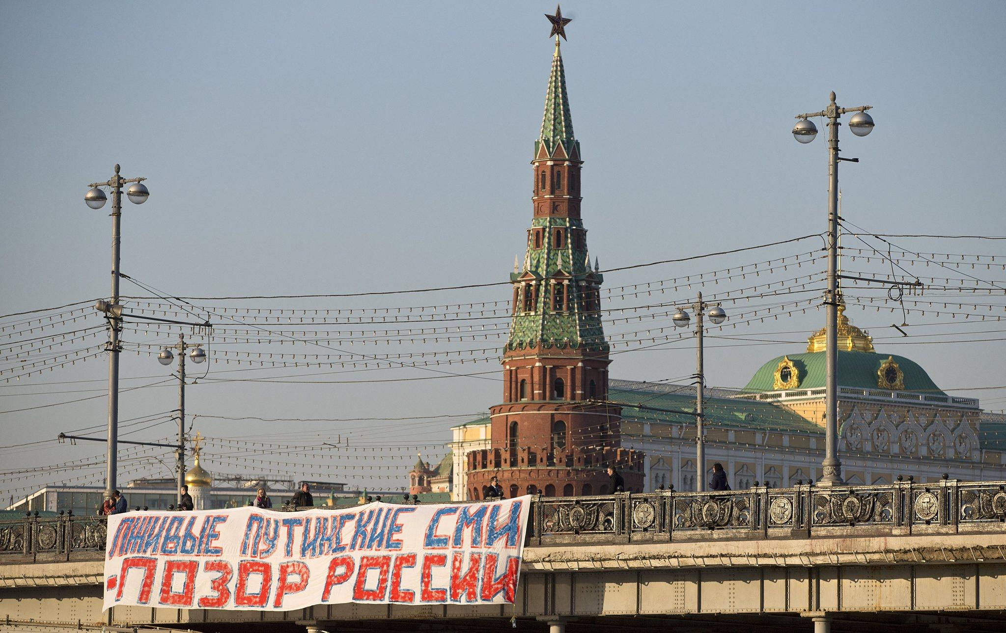 "A banner reading ""Putin's lying media are the shame of Russia"" hangs from a bridge near the Kremlin on Friday. The Russian government has refused to renew a broadcasting license for Voice of America, adding the U.S.-funded news and cultural programmer to the list of media silenced by the Kremlin."