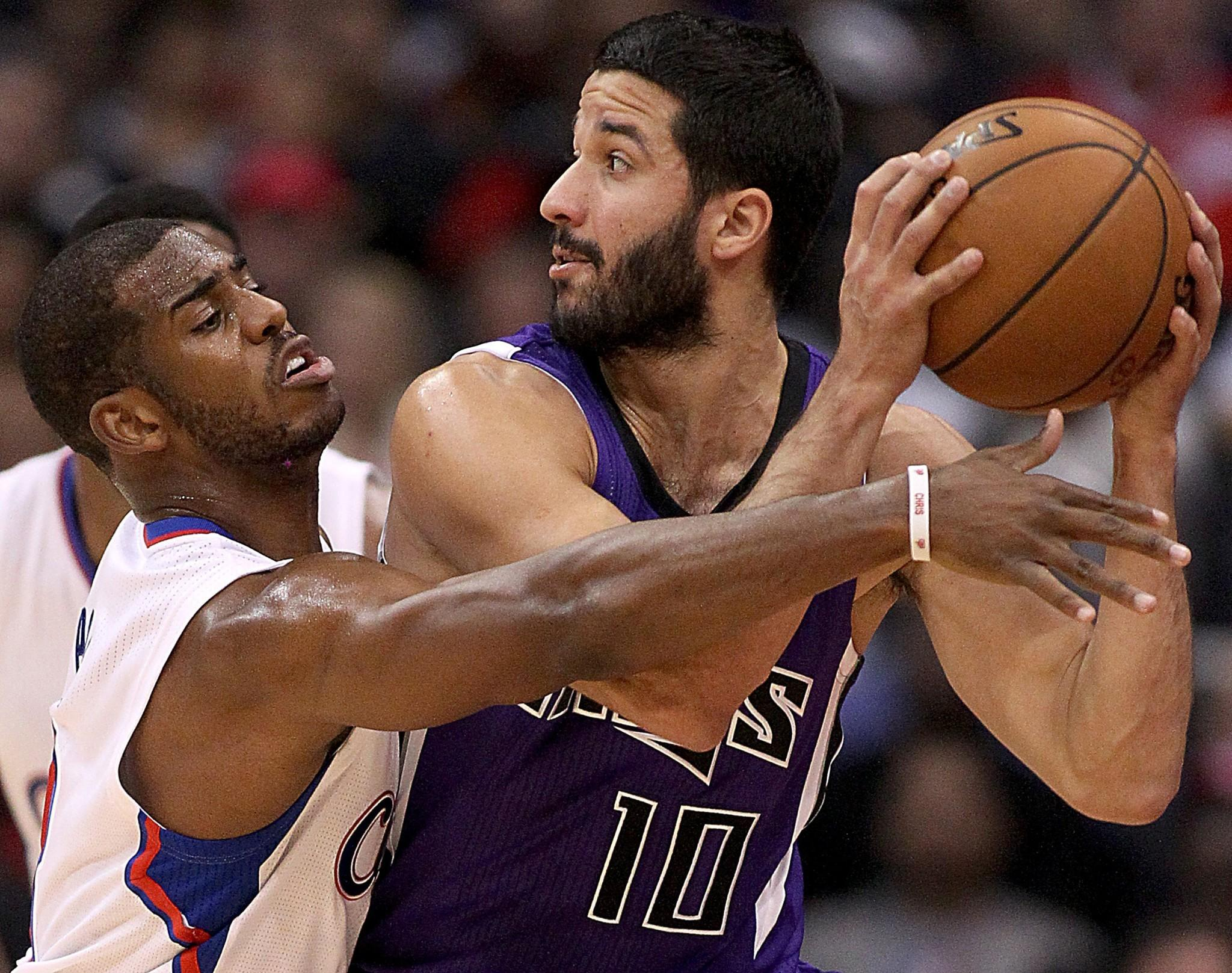 Clippers point guard Chris Paul tries to steal the ball from Kings guard Greivis Vasquez during a game earlier this season.