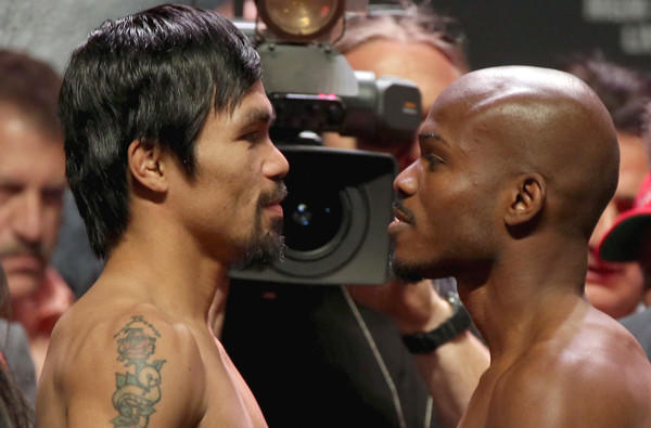 Manny Pacquiao, left, and Timothy Bradley stand toe to toe after their weigh-in on Friday.