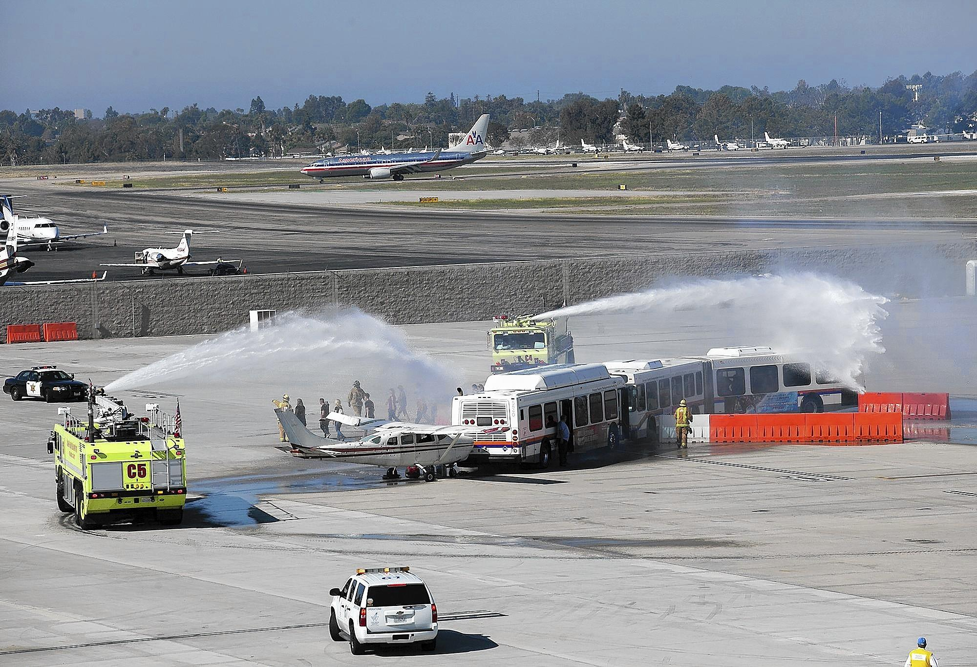 John Wayne Airport conducts a full-scale mass-casualty drill involving OCTA buses, simulating a Boeing 737, and a small Cessna on Friday.