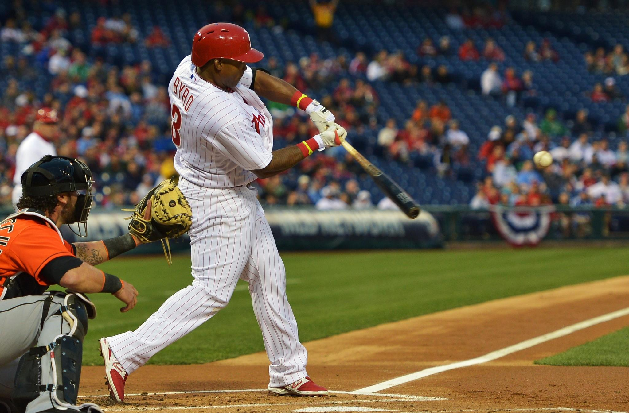 Marlon Byrd #3 of the Philadelphia Phillies hits a one run double in the first inning against the Miami Marlins at Citizens Bank Park on April 11, 2014 in Philadelphia, Pennsylvania.