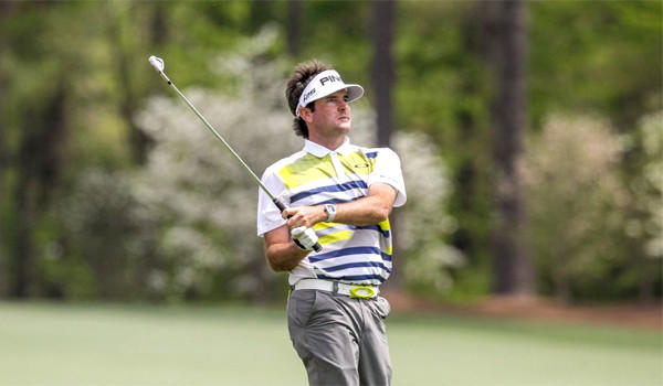 Bubba Watson watches his shot to the 12th green during the second round of the Masters at Augusta National Golf Club. Watson finished the second round with a four-under par 68.