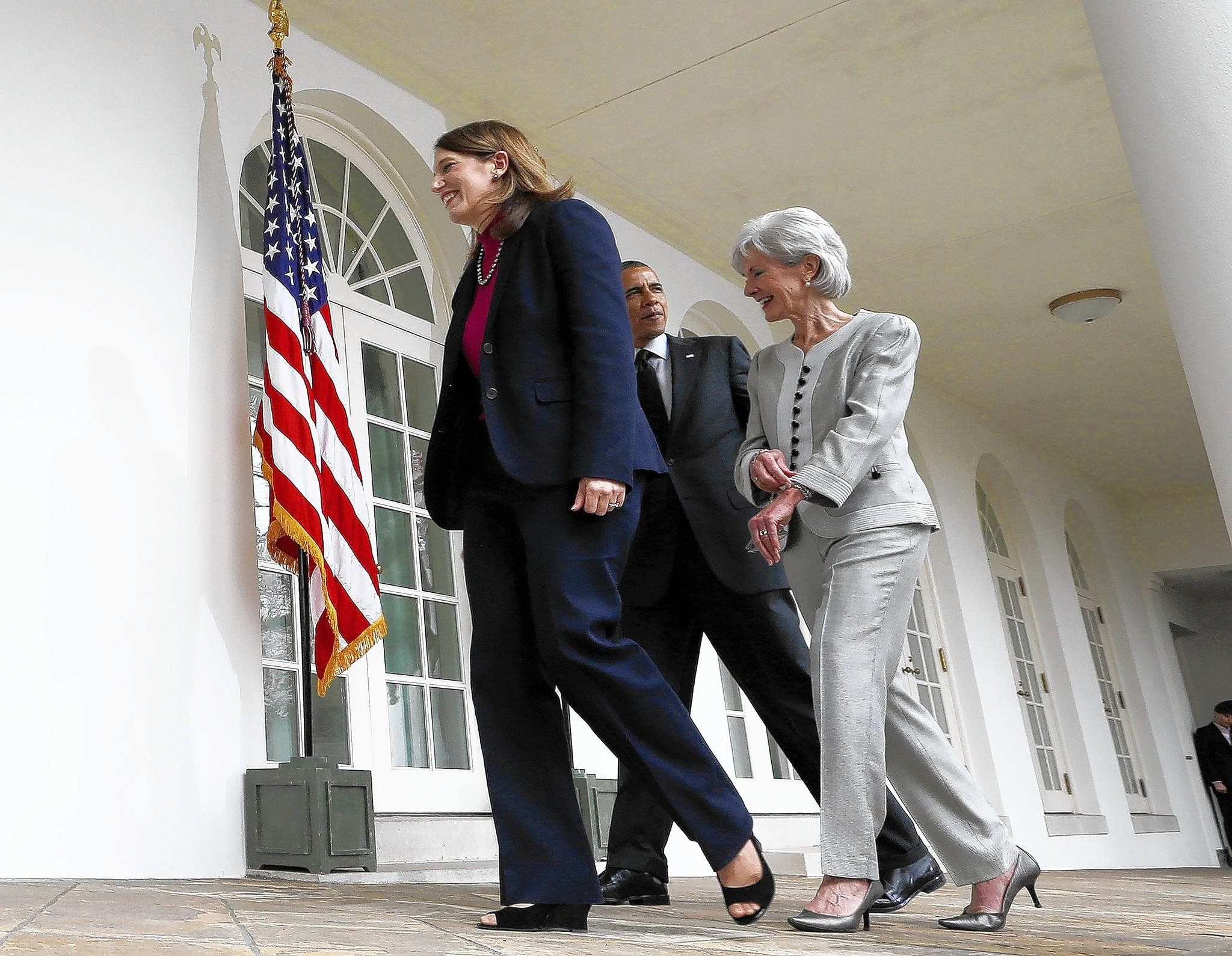 President Obama leaves the White House Rose Garden with outgoing Health and Human Services Secretary Kathleen Sebelius, right, and his nominee to replace her, budget director Sylvia Mathews Burwell.