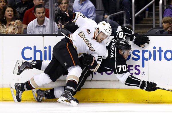 Ducks defenseman Mark Fistric checks Kings left wing Tanner Pearson during the second period of a game last month at Staples Center.