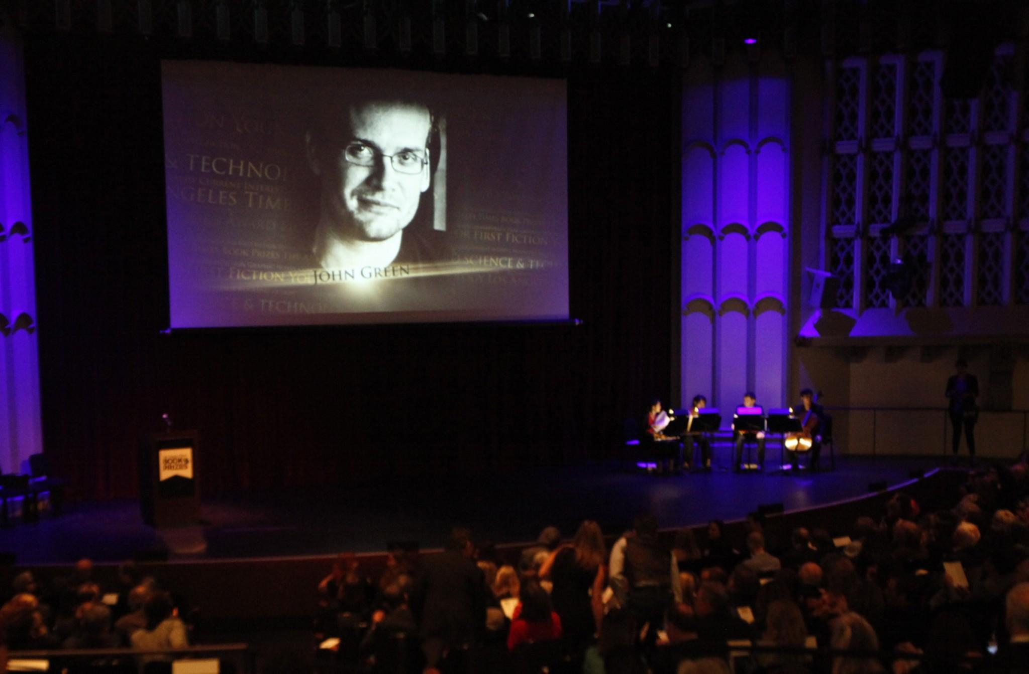 The image of author John Green is projected on the screen at the start of the 34th Annual Los Angeles Times Book Prizes event at USC.