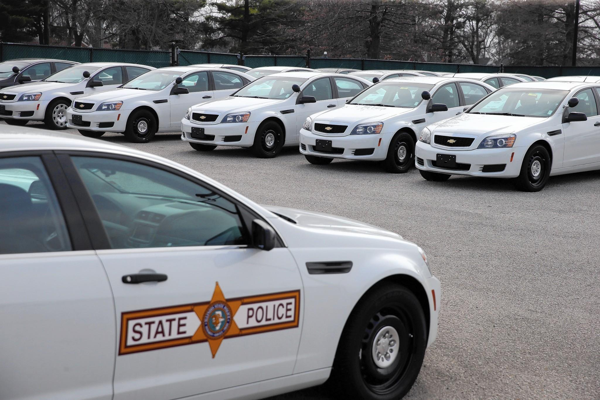 A parking lot at the Illinois State Fairgrounds in Springfield is full of new, but unused, state police squad cars.