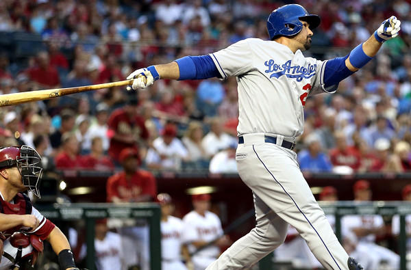Dodgers first baseman Adrian Gonzalez follows through on a two run home-run against the Arizona Diamondbacks in the first inning Friday night in Phoenix.