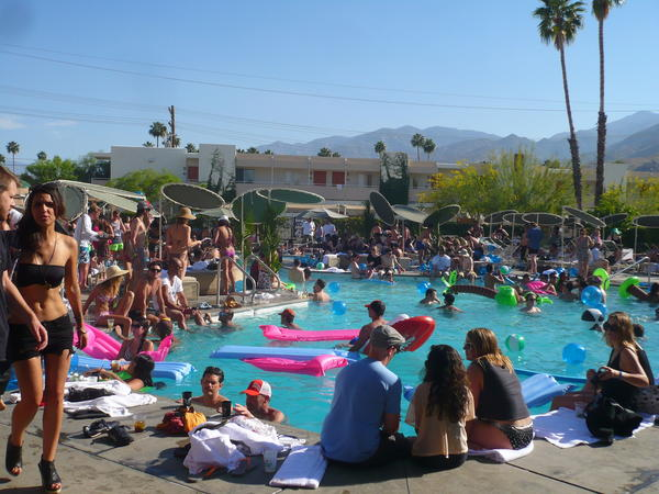 People party poolside at the Palm Springs Ace Hotel at a Coachella gone by.