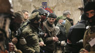 Gunmen seize more sites in eastern Ukraine as official blames Russia